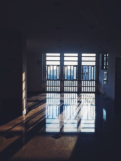 Sunlight falling on tiled floor through window