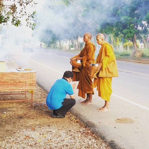 Buddhist Alms Giving Monks Locals Country Road Morning Thailand Barefoot Smoke Foggy Morning