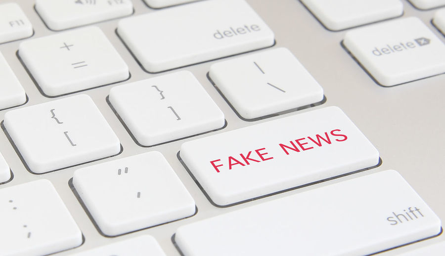 "Close-up of a keyboard with the expression ""Fake News"". Concept Image. Isolated Press Virtual Announcement Close Up Communication Computer Concept Control Data Factory Fake News False Fraud Information Keyboard Lies Message Mislead Publication"