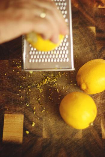 Close-up of yellow lemons on cutting board