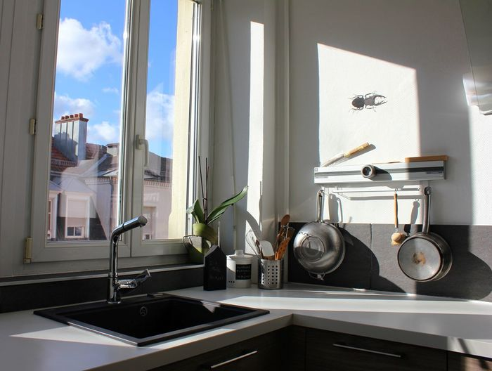 Sink At Kitchen Counter By Window