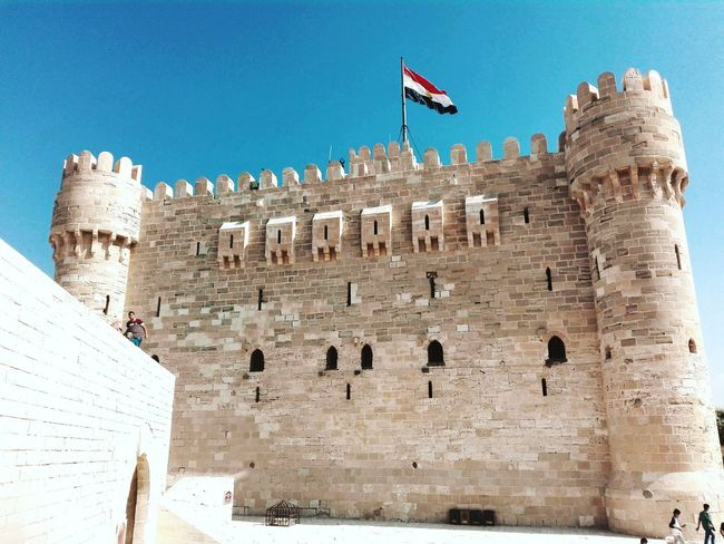 Flag Travel Outdoors No People History Travel Destinations Built Structure Tourism Architecture Building Exterior Sky Day Alexandria Egypt Cityscape Qaitbey Citadel Patriotism Egypt My Year My View Nature Scenics
