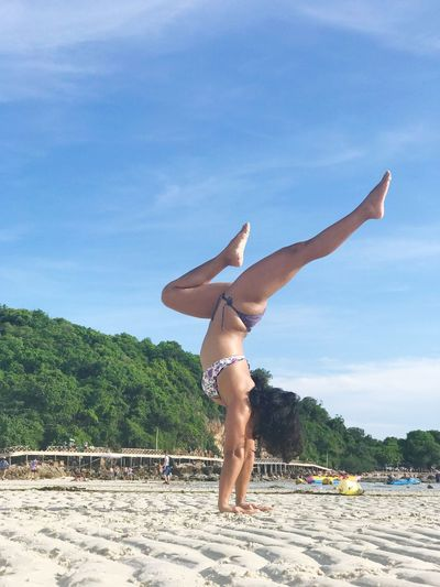 Yoga Yoga Pose Yoga Girl Handstand  Sky Real People Full Length Lifestyles Young Adult One Person Leisure Activity Nature Day Carefree Handstand  Sunlight Swimwear Balance Upside Down Shirtless Young Women Strength Human Arm Women