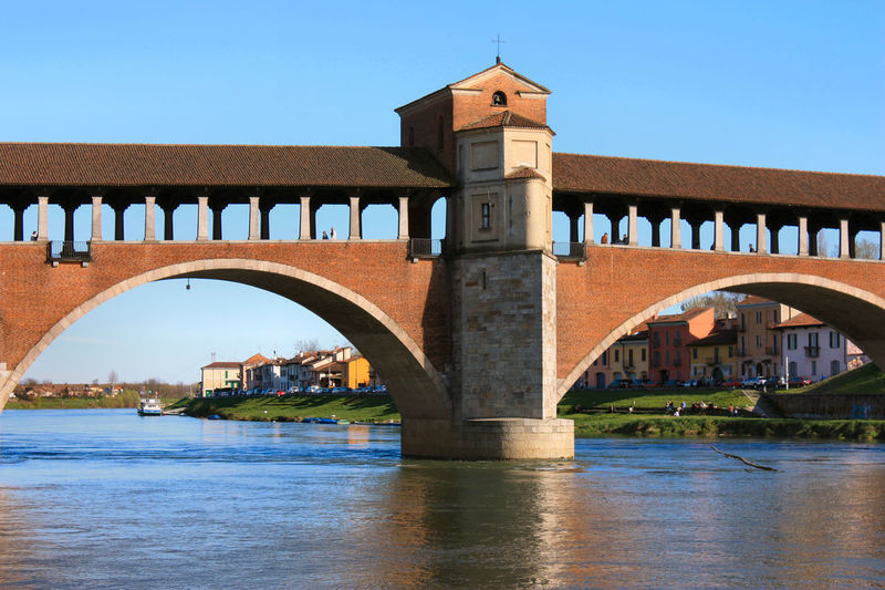 Walking around Brick Wall Pavia Reflection Arch Architecture Bridge - Man Made Structure Building Exterior Built Structure Clear Sky Connection Covered Bridge Day Nature No People Outdoors Reflections In The Water River Sky Ticino River Water