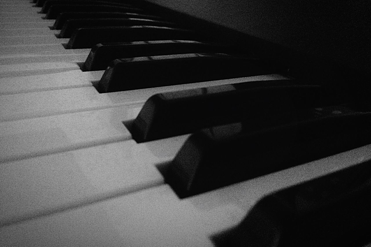 piano key, piano, musical equipment, musical instrument, in a row, no people, indoors, music, close-up, arts culture and entertainment, shadow, keyboard, high angle view, keyboard instrument, white color, pattern, still life, sunlight, black color, diminishing perspective