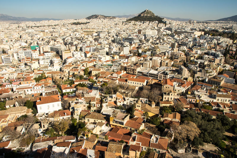 Ancient city, new perspectives Ancient EyeEm City Shots Architecture Athens Building Building Exterior Built Structure City Cityscape Community Crowd Crowded Day Greece High Angle View House Metropolis Mountain Nature Outdoors Residential District Roof Sky Town TOWNSCAPE