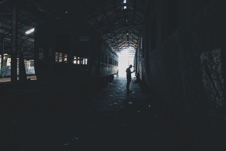 One Man Abandoned Africa Architecture Built Structure City City Life Day Indoors  Lagos Man Men Nigeria One Man Only One Person People Railroad Station Real People Ruined Street Street Photography Streetphotography The Way Forward Tunnel Urban Urban Geometry