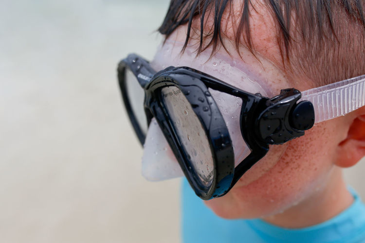 Boy Wearing Goggles on the Beach by the Ocean One Person Real People Headshot Portrait Close-up Focus On Foreground Outdoors Goggles Beach Ocean Boy Kids Childhood Childhood Memories Beach Photography Panhandle Destin  Destin FL