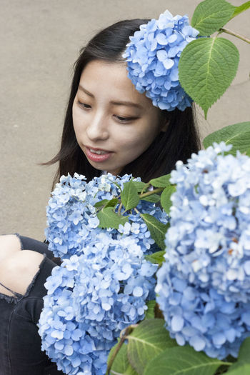 Never doubt yourself Ajisai Beauty In Nature Blooming Blue Bouquet Close-up Day Flower Flower Head Fragility Freshness Growth Hydrangea Leaf Nature One Person Outdoors People Petal Plant Real People Scented Smelling Young Adult Young Women