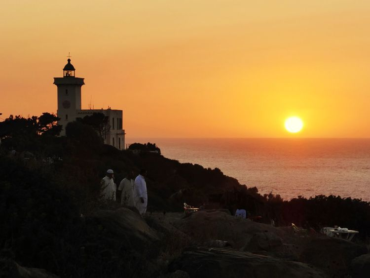 sunset Tanger Tanger  Morocco Africa Sunset Lighthouse Silhouette Reflection Travel Destinations Vacations Sky Beach Outdoors Architecture Building Exterior Sun Horizon Sea Landscape Business Finance And Industry Tranquility Horizon Over Water Nature Scenics