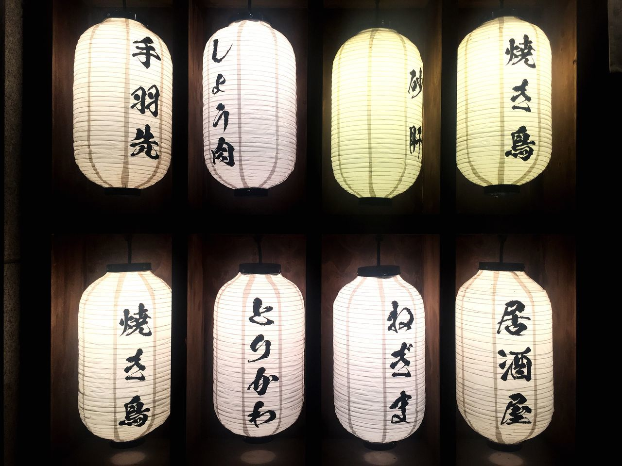 text, number, in a row, communication, wood - material, no people, cultures, indoors, hanging, bamboo - material, spirituality, backgrounds, close-up, day