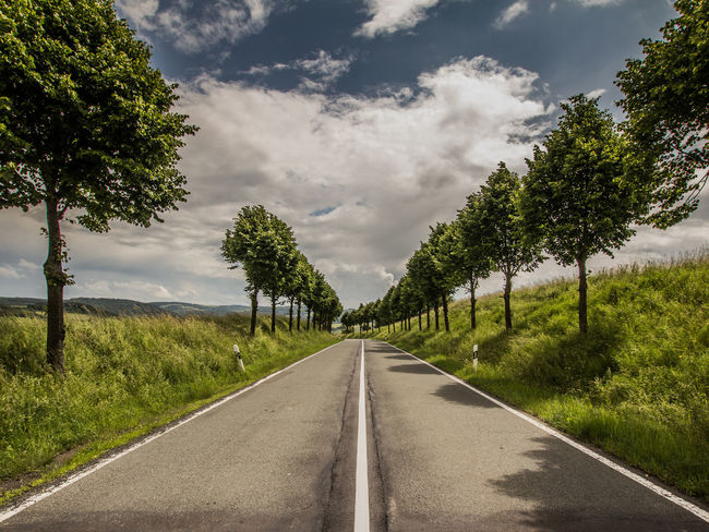 Cloud - Sky Clouds And Sky Day Grass Landscape Lines Nature No People No Traffic Outdoors Road Road Scenics Sky The Way Forward Tree Trees