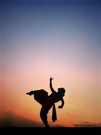Sillhoute of a bharthanatyam dancer women women around the world