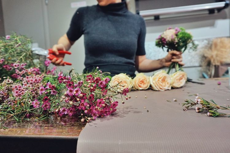 Midsection of florist standing at table
