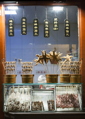 Beijing China Abundance Arrangement Beijing Beijing China Chinese Culture Chinese Fast Food Chinese Food Chinese Street Food Chinese Street Photography Choice Cityscape Collection Day Display Large Group Of Objects No People Retail  Scorpion On A Stick Shelf Shop Starfish On A Stick Stick Food Still Life Store Variation