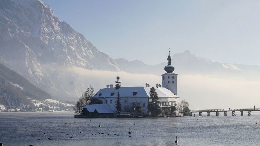 Castle in lake surrounded with mountains