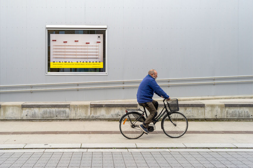 minimal standard Architecture Bicycle Built Structure City City Life Copy Space Full Length Lifestyles Men Mode Of Transportation Motion One Person Porsgrunn Real People Side View Technology Transportation Wall - Building Feature ælvespeilet