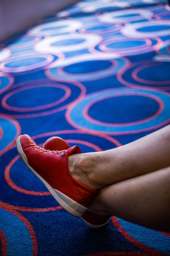 Low section of woman wearing canvas shoes at swimming pool