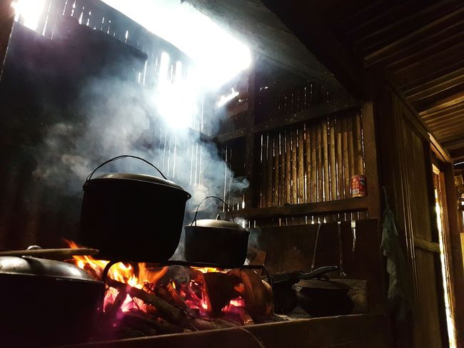 Dirty kitchen Dirty Kitchen Cooking Fire Smoke Tropical Shadows & Lights Heavy Smoke Pot And Kettle Cooking With Fire Indoor Wooden Hut Wooden Kitchen