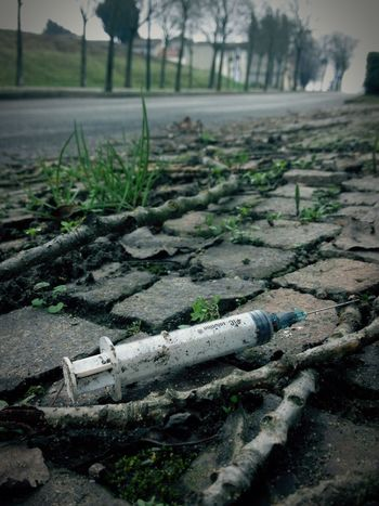 on the way to the cemetery... I thought that abandoned syringes were a thing of the past DrugAddiction Drug Syringe Heroin Italy Abandoned