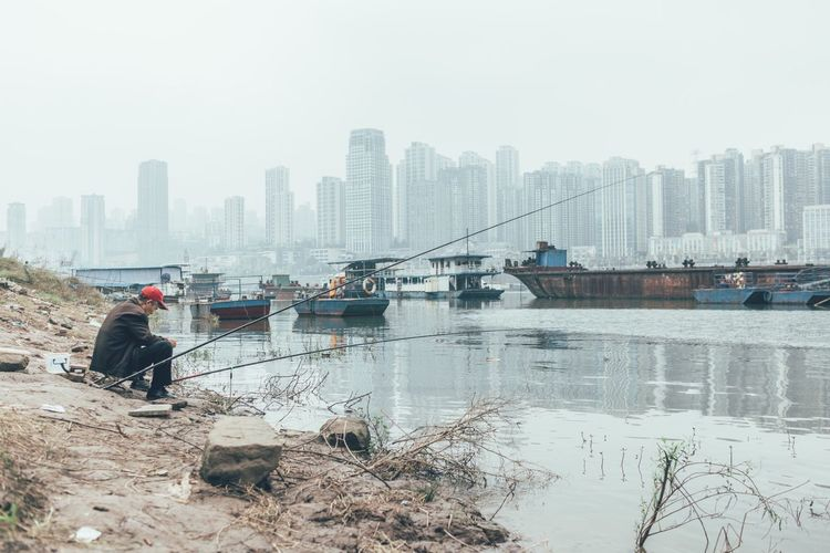 China Fishing Skyscraper Urban Skyline Day City Dust Skyline Adopted To The City Documentary EyeEm Best Shots The Week Of Eyeem Journey Travel Photography Eye4photography  City TakeoverContrast VSCO Vscocam River Water Urban Check This Out Redstartravel Adapted To The City