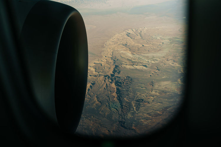 passenger view from an airplane with turbine and mountain range in Iran Air Vehicle Airplane No People Scenics - Nature Transportation Nature Flying Mountain Landscape Mode Of Transportation Vehicle Interior Environment Day Aerial View Indoors  Beauty In Nature Jet Engine Window Travel Technology Turbine Iran Mountain Range