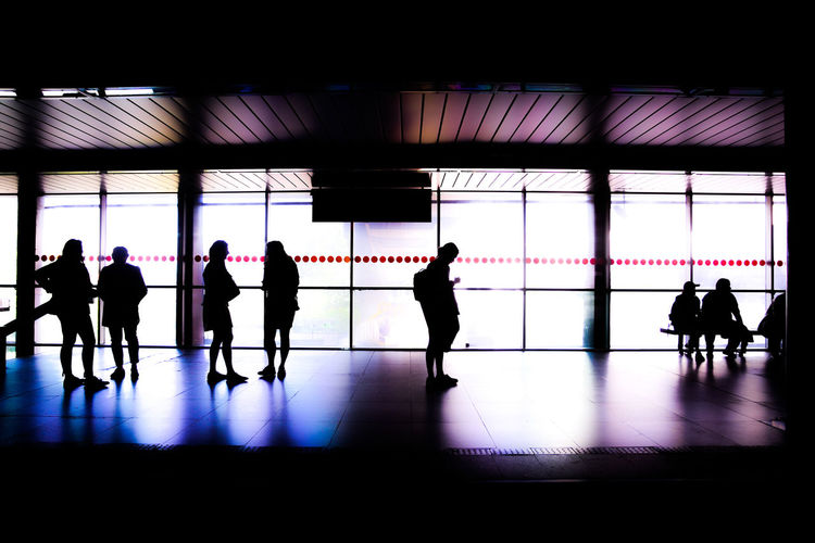 Adult Airport Architecture Day Flooring Group Group Of People Indoors  Leaving Lifestyles Medium Group Of People Men People Real People Silhouette Transportation Travel Waiting Walking Window Women