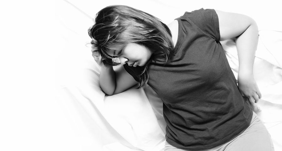 depressed woman on white background Sadness And Sorrow Worried Bed Black And White Close-up Day Depression - Sadness Female Girls Headache Indoors  One Person People Sadness Tensed Tension Thingking  Tired! White White Background
