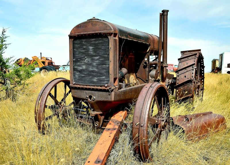 Tractor Outdoors North Of Douglas Wyoming Clouds And Sky Junkyard Rusted Old Weathered Metal Abandoned Rural Scene Agricultural Machinery Old-fashioned Rusty Tractor Agricultural Equipment Deterioration