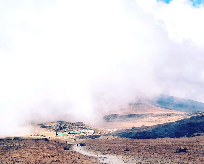 Kibo hut, Mount Kilimanjaro on our way down from the summit with Mawenzi Peak party covered by clouds Mountaineering Hike Above The Clouds Mount Kilimanjaro Fog Travel Mountains Mount Kilimanjaro National Park Mountain Range Mawenzi Peak Kibo Hut Power In Nature Sand Extreme Terrain Sky