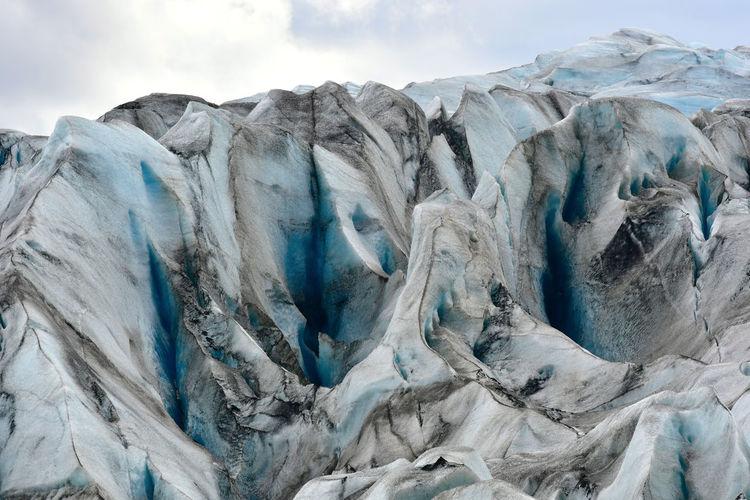 Full frame shot of glacier ice against sky