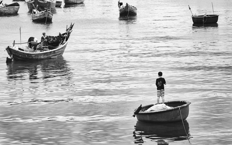 Adult Boat Day Fishing Full Length Lifestyles Men Mode Of Transport Muine Nature Nautical Vessel Occupation One Person Outdoors People Real People Rear View Sea Standing Transportation Vietnam Water Waterfront