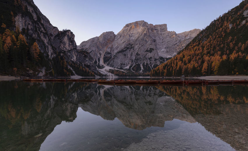 Reflection of mountain in lake against clear sky