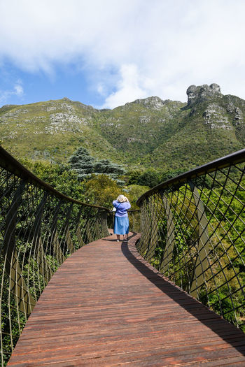 Adventure Bridge - Man Made Structure Canopy Walk Clouds Mountain Mountain Range Nature Nature Reserve One Person Perpective Scenics Sky The Way Forward Tranquility