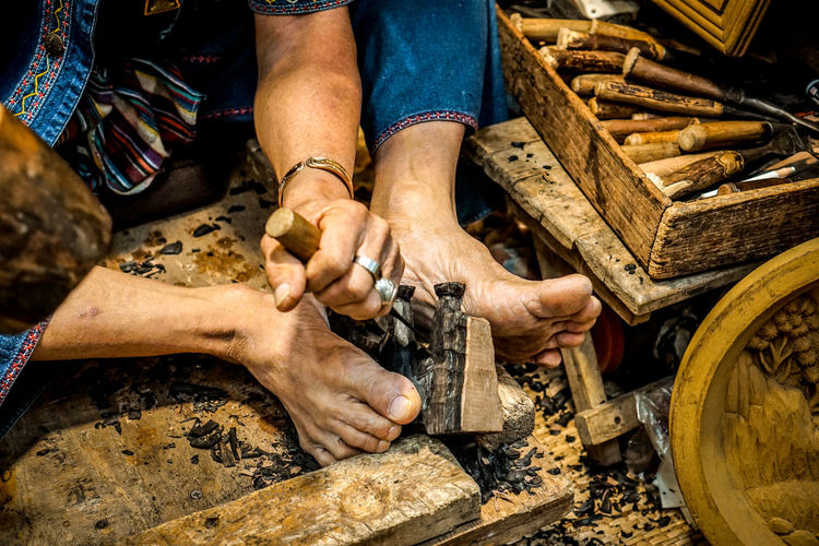 High angle view of artist carving wood
