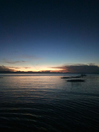 A Tranquil View of the port of Panukulan, Quezon in the Polillo Group Of Islands . Located off the port of Infanta, Quezon , to reach this place requires several transfers of transportations. A Sunset View from the eastern part of the Philippines . Pacific Ocean Pacific Ocean Sunset Sea Outdoors Travel Destinations Water Sky Beauty In Nature Seascape No Filter No Edit No Filter Photography EyeEm EyeEm Nature Lover Eyeemphotography Eyeem Philippines Polillo EyeEmNewHere
