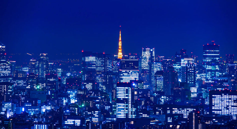Asia Business concept for real estate & corporate construction - panoramic modern city skyline night view with expressway in Ikebukuro district, Tokyo, Japan Ikebukuro District Tokyo,Japan Urban Skyline City Blue Sky Modern Cityscape Expressway Highway Road Speed Light Trail Future Technology Science Fiction Motion Bright Light Office Building Aerial View Panoramic Night Evening Sky Twilight Sky neon life Skyscraper Real Estate Agent Tokyo Tower