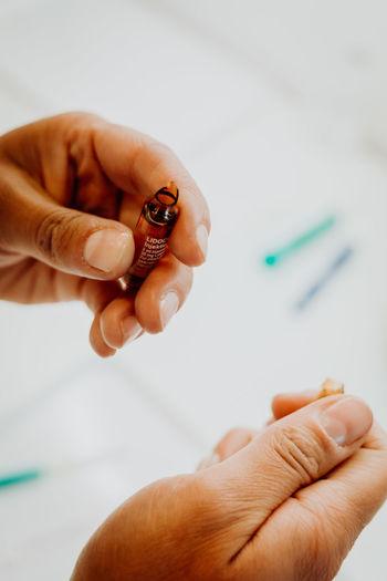 Close-up of human hand holding syringe