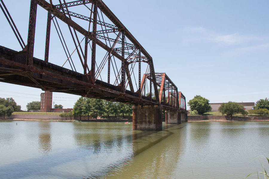 Rustic railroad trestle Railroad Track Architecture Bridge Bridge - Man Made Structure Built Structure Connection Day Engineering Girder Low Angle View Metal Nature Outdoors Plant River Sky Transportation Tree Trestle Water Waterfront