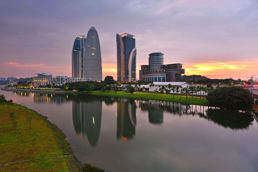 Reflections of buildings during sunset Reflection Sky And Clouds Sunset_collection View Travel Destinations Outdoor Landscape Lake Skyline EyeEm Nature Lover EyeEm Selects Getty Images EyeEm Best Shots Beauty In Nature Beautiful EyeEm Gallery Sunrise Malaysia City Cityscape Urban Skyline Water Modern Illuminated Skyscraper Sunset Politics And Government Multi Colored Panoramic Modern Art