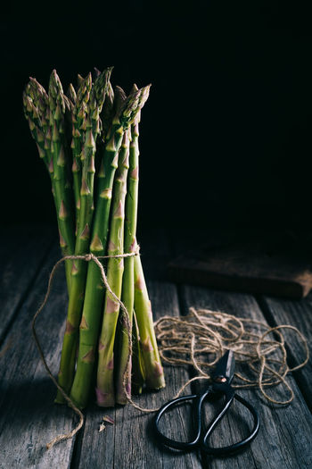 bunch of green asparagus on wooden board and black background   food photography Food And Drink Freshness Table Wood - Material Food Vegetable Bundle Still Life Asparagus Green Color Bunch No People Black Background Tied Up Food Photography Nikonphotographer Light And Shadow Healthy Eating Raw Food Studio Shot