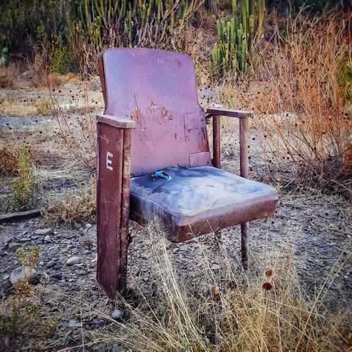 Old chair in the middle of nowhere Chair Old Garbage Movietheater Relax Landscape Day No People Outdoors Water Close-up
