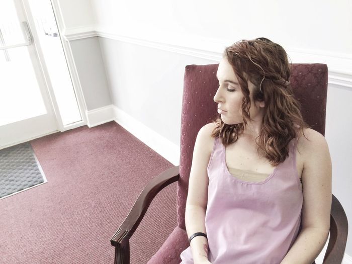 Young woman relaxing on chair at home
