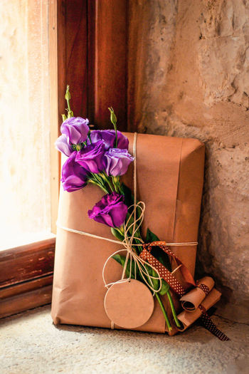 Decorative gift Exfoliated Paper Beauty In Nature Close-up Decoration Flower Flower Arrangement Flower Head Flowering Plant Freshness Gift Indoors  Nature No People Old Paper Paper Currency Petal Purple Ribbon - Sewing Item Still Life Window