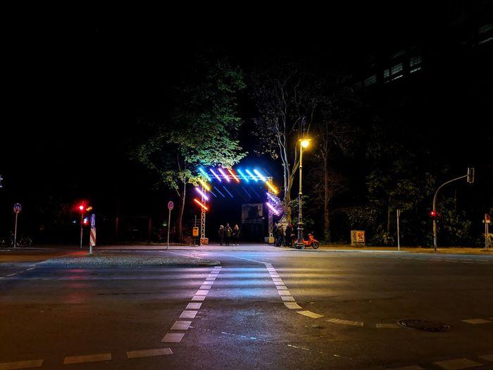 Warsaw in Berlin. City Illuminated Tree Water Street Light Street Road Sky