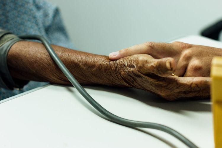 Cropped hand of doctor checking patient blood pressure