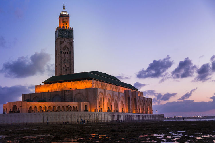 Hassan ii mosque against sky during sunset