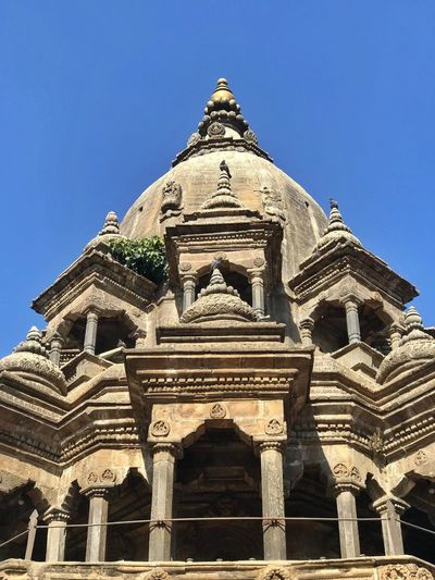 Ancient temple in Patan Durbar Square, Nepal Worship Place Nepal Tourism Patan Durbar Square Architecture Built Structure Low Angle View Building Exterior Religion Place Of Worship Spirituality Outdoors History Travel Destinations Blue Ancient Civilization No People Clear Sky Day Sky