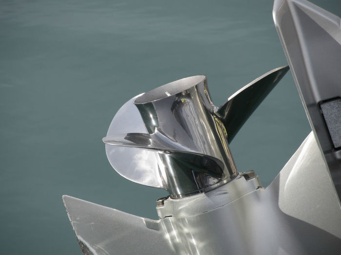 Outboard boat motor tuned up and trying on the first run on sea background Boating Hull Lifestyle Motor Power Rotor Boat Detail Engine Equipment Fan Metal Motorboat Motorized Nautical Outboard Piston Propeller Screw Speedboat Steel Transparent Turbine Vehicle Water