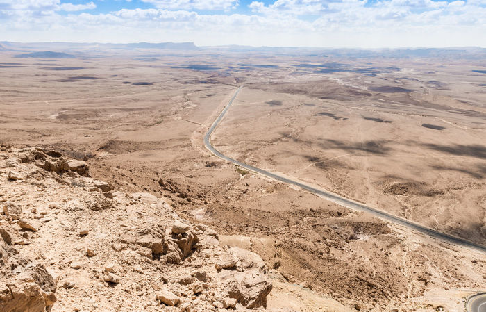 View from the top of the mountain in the early morning to the Judean desert near the town of Mitzpe Ramon in Israel Cloud Freshness Morning Sun Sunlight Top Of The Mountain Travel Trip View Background Beauty In Nature Blue Sky Day Early Morning Idyllic Israel Judean Desert Landscape Mitzpe Ramon Scene Sky Stone Sunrise Terrain Tourism Tranquility